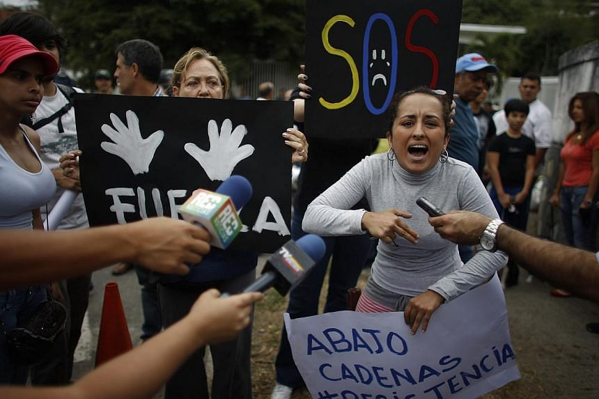 A demonstrator yells during a protest near the Cuba's Embassy in Caracas on Feb 25, 2014.  Student protesters marched toward the Cuban Embassy on Tuesday in yet another day of anti-government demonstrations in Caracas as the United States (US) a