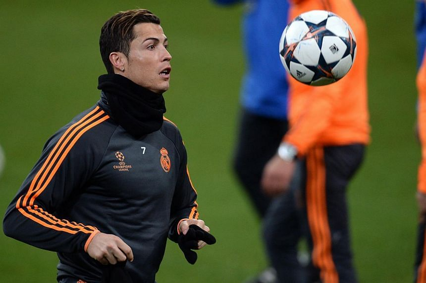 Real Madrid's Portuguese forward Cristiano Ronaldo warms up during a training session on the eve of the first-leg round of 16 Uefa Champions League football match Schalke 04 vs real Madrid in Gelsenkirchen, western Germany on Feb 25, 2014. The Ballon