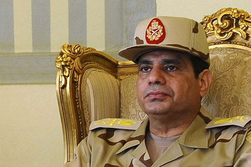 Egypt's Defense Minister Abdel Fattah al-Sisi is seen during a news conference in Cairo, in this May 22, 2013 file picture. Egyptian army chief Field Marshal Abdel Fattah al-Sisi will keep his post as defence minister in a new government, an official