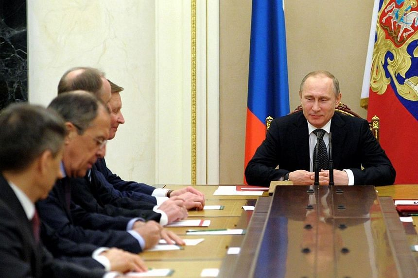 Russia's President Vladimir Putin chairs a Security Council meeting in the Kremlin in Moscow, on Feb 25, 2014.President Vladimir Putin ordered an urgent drill to test the combat readiness of the armed forces across western Russia on Wednesday,