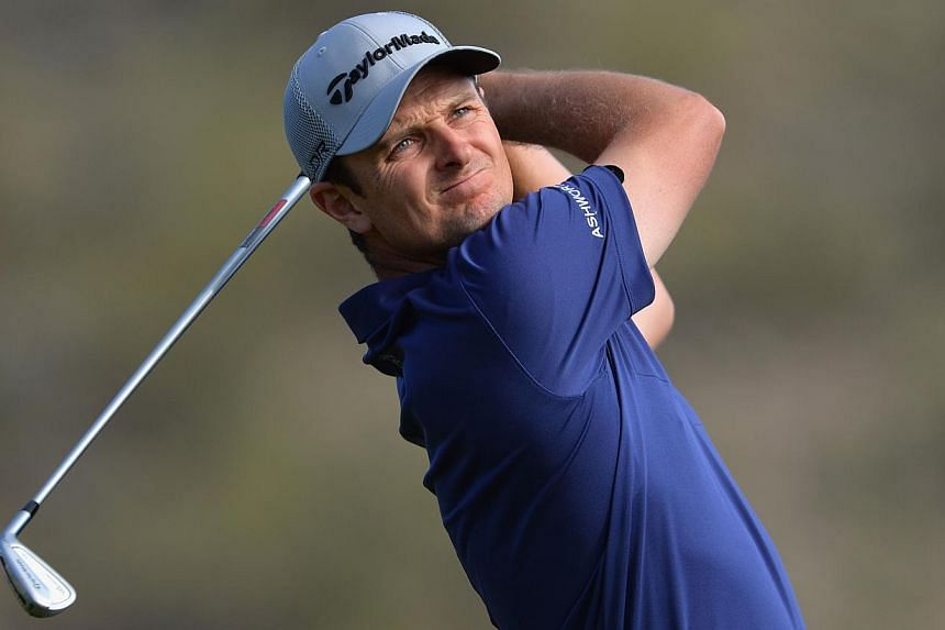 World number six Justin Rose of Britain has withdrawn from this week's US$6 million (S$7.6 million) United States PGA Tour Honda Classic to rest a nagging right shoulder injury, the tour announced on Feb 25, 2014. -- FILE PHOTO: AFP