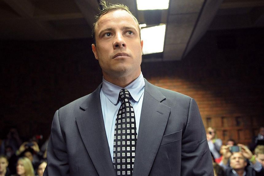 South African Paralympic sprinter Oscar Pistorius appearing at Magistrate Court in Pretoria for the first time on June 4, 2013,since being freed on bail in February over the Valentine's Day killing of his model girlfriend. -- FILE PHOTO: AFP