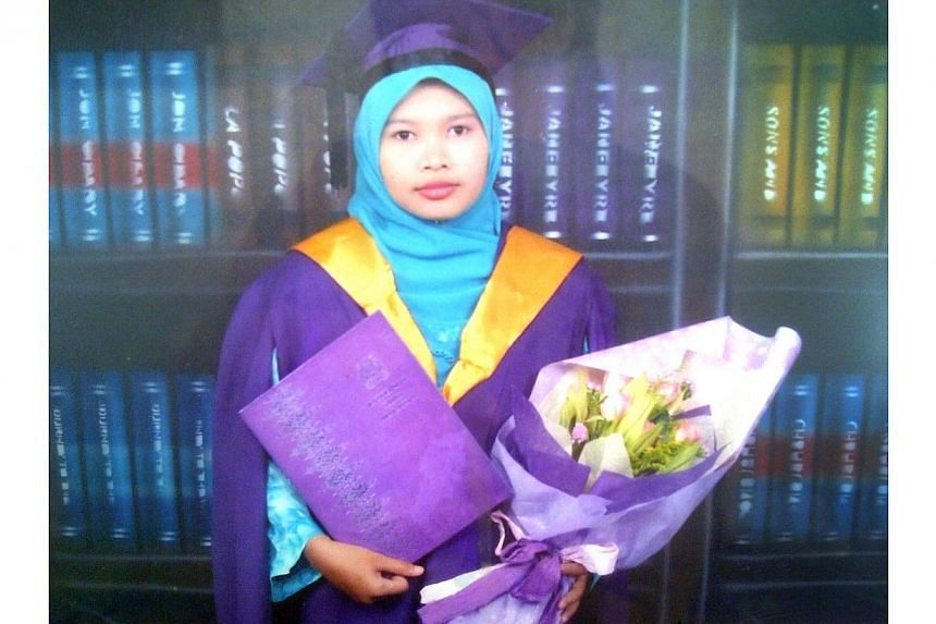 Malaysian Nurul Ruhana Ishak, who was arrested for illegally entering the Ministry of Foreign Affairs headquarters on Jan 20, 2014. She now faces three charges after appearing in court for the first time on Feb 26, 2014. -- FILE PHOTO: THE STAR