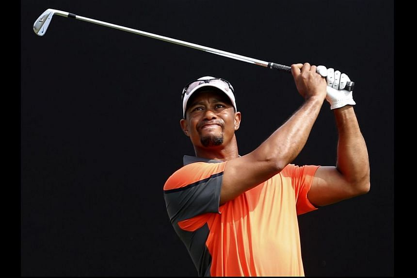 US Tiger Woods tees a shot during the third round of the 2014 Omega Dubai Desert Classic on Feb 1, 2014, in Dubai, United Arab Emirates. HSBC's sponsorship chief has urged Woods to respect the bank's large investment by playing at this year's WG