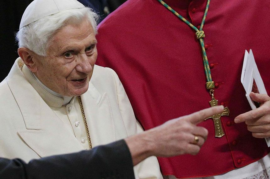Pope Emeritus Benedict XVI arrives to attend a consistory ceremony in Saint Peter's Basilica at the Vatican onFeb 22, 2014. Former Pope Benedict, in one of the few times he has broken his silence since stepping down nearly a year ago, has brand