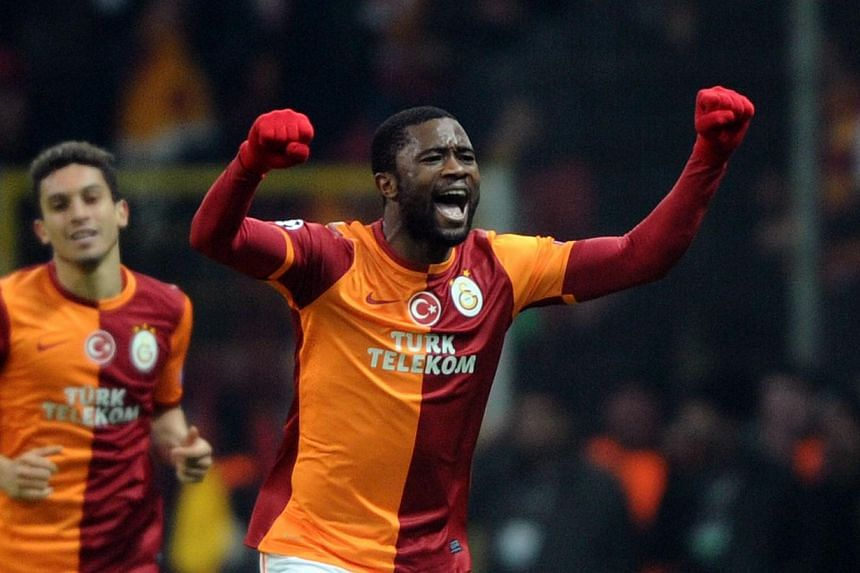 Galatasaray's Cameroonian defender Aurelien Chedjou (right) celebrates after scoring a goal during the Uefa Champions League round of 16 football match between Galatasaray and Chelsea on Feb 26, 2014, at the TT Arena Stadium in Istanbul. -- PHOTO: AF