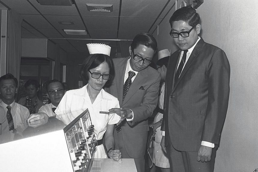 Former Minister for Health and Home Affairs, Mr Chua Sian Chin (right) at the opening of the Coronary Care Unit at Outram Hospital on Nov 30, 1973. -- ST FILE PHOTO: FRANCIS ONG PUAY GUAN