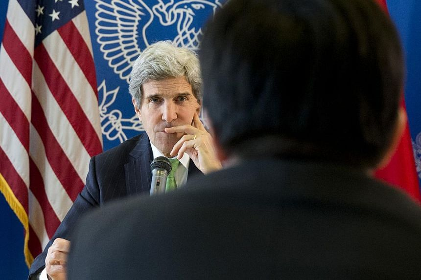 File picture of US Secretary of State John Kerry taken earlier this year as he listens to a question during a discussion with bloggers on a number of issues, including China's relationship with North Korea. -- PHOTO: AFP