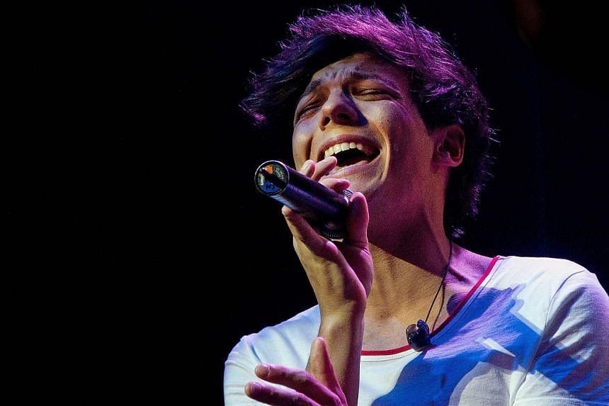 British singer from One Direction, Louis Tomlinson, performs during the group's concert at the St James theatre in Wellington, New Zealand on April 22, 2012. Tomlinson played for Doncaster Rovers on Feb 26, 2014. -- FILE PHOTO: AFP