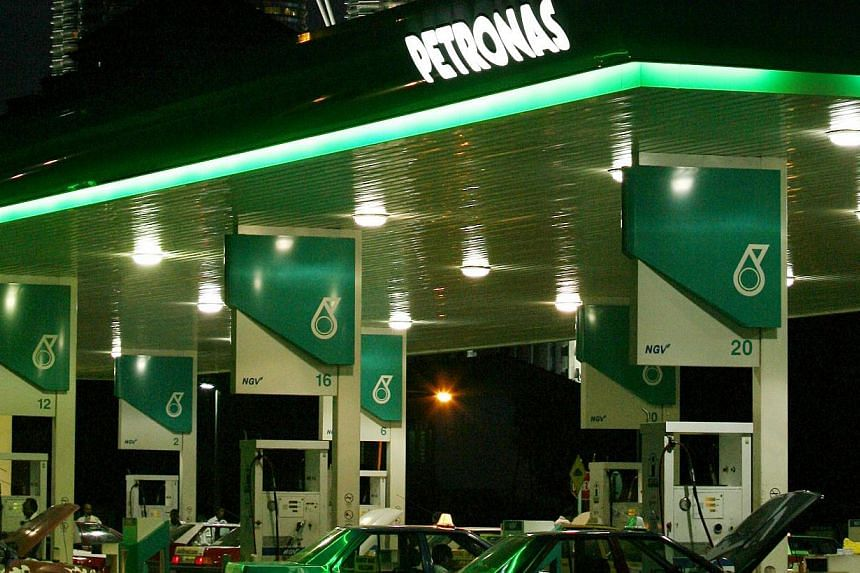 Petronas wants to sell its stakes in five offshore oilfields in Vietnam for a combined US$300 million (S$379 million), two company sources said, as the Malaysian state oil firm streamlines its assets and raises funds for expansion. -- FILE PHOTO: BLO