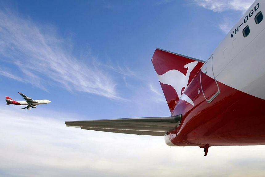 Struggling Australian carrier Qantas on Thursday said it will take measures including cutting 5,000 jobs and ending its Perth-Singapore route in a major shake-up after a first-half net loss of A$235 million (S$267 million), warning of more pain ahead