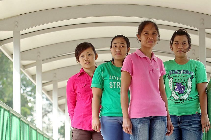 Indonesian maids (from left) Tati Jupran, 30, Triani, 26, Suharni, 28, and Wiwin Winengsih, 30, asked for a change of employers because they were not given a day off. -- ST PHOTO: SEAH KWANG PENG