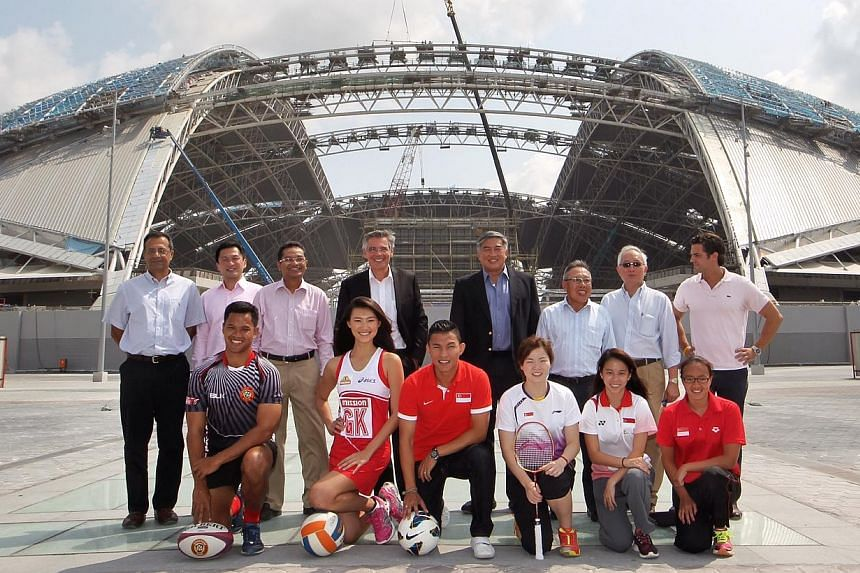 Singapore national athletes (front row) and officials from the various national sporting associations (back row) line up for a group photograph together with the SportsHub Pte Ltd CEO Philippe Collin Delavaud (back row, fourth from left) in front of