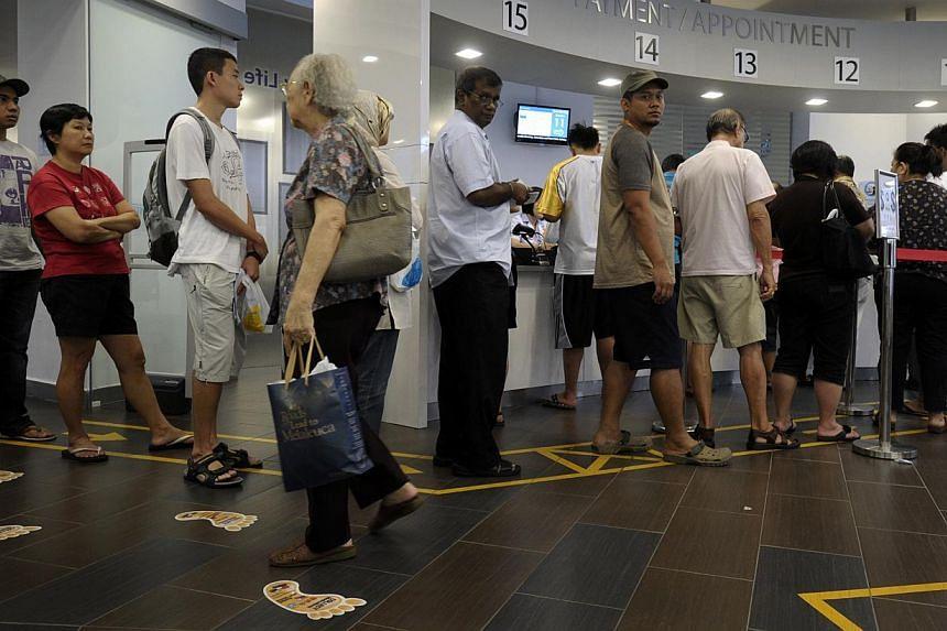 A queue at Choa Chu Kang Polyclinic. -- ST FILE PHOTO: JOSEPH NAIR