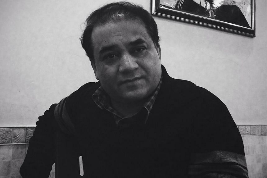 Ilham Tohti, an economics professor at Beijing's Minzu University, sits in a restaurant in Beijing, in this handout picture taken on Jan 8, 2014. The United States on Wednesday, Feb 26, 2014, urged China to free a prominent Uighur academic who faces