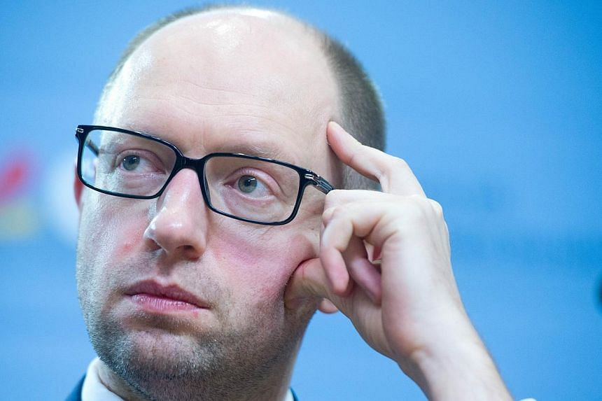 Ukraine opposition leader Arseniy Yatsenyuk addresses a press conference in Berlin on Feb 17, 2014, after a meeting with the German Chancellor to discuss the country's crisis. Ukraine's new prime minister Arseniy Yatsenyuk on Thursday accused the gov