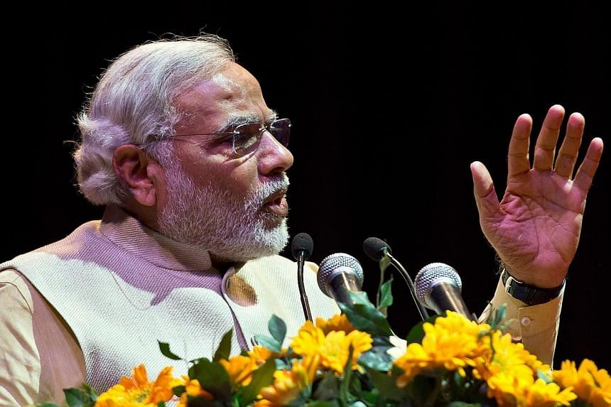 Bharatiya Janata Party (BJP) prime ministerial candidate and Chief Minister of the western Indian state of Gujarat Narendra Modi delivers a speech during the national convention of the Confederation of All India Traders (CAIT) in New Delhi on Feb 27,