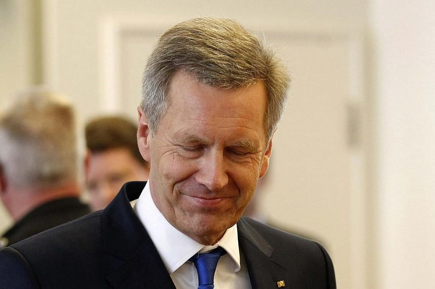Former German President Christian Wulff arrives for his trial at the regional court in Hanover Feb 27, 2014. A German court cleared Mr Christian Wulff on Thursday of corruption charges for accepting about 700 euros in expenses at a beer festival when