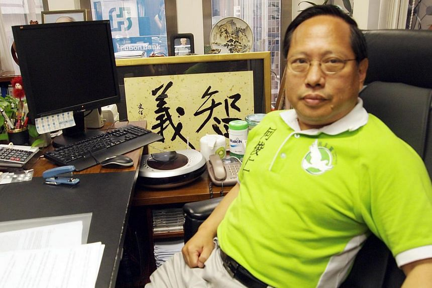 Hong Kong lawmaker Albert Ho (above) has apologised after he was photographed looking at scantily-dressed pictures of models on his tablet computer during a budget speech at the Chinese city's parliament.-- ST FILE PHOTO: LI XUEYING