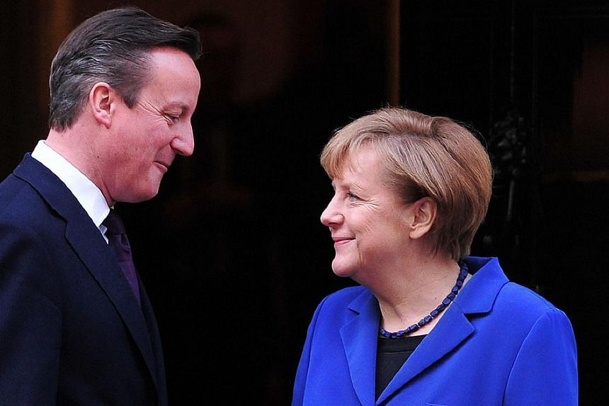 British Prime Minister David Cameron (left) greets German Chancellor Angela Merkel outside 10 Downing Street in London, on Feb 27, 2014. German Chancellor Angela Merkel urged Britain on Thursday to stay in the EU but played down David Cameron's hopes