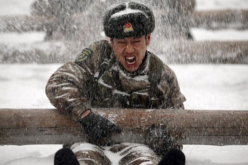 Soldiers take part in a drill during a heavy snow in Heihe, Heilongjiang province, China. -- PHOTO: REUTERS