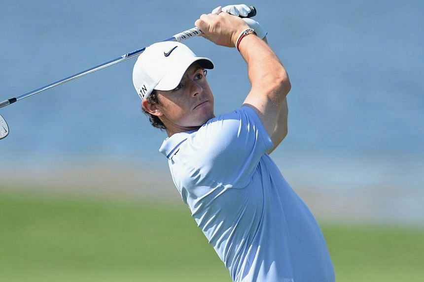 Rory McIlroy of Northern Ireland plays a shot during the pro-am prior to the start of the Honda Classic at PGA National Resort and Spa on Feb 26, 2014 in Palm Beach Gardens, Florida. -- PHOTO: AFP