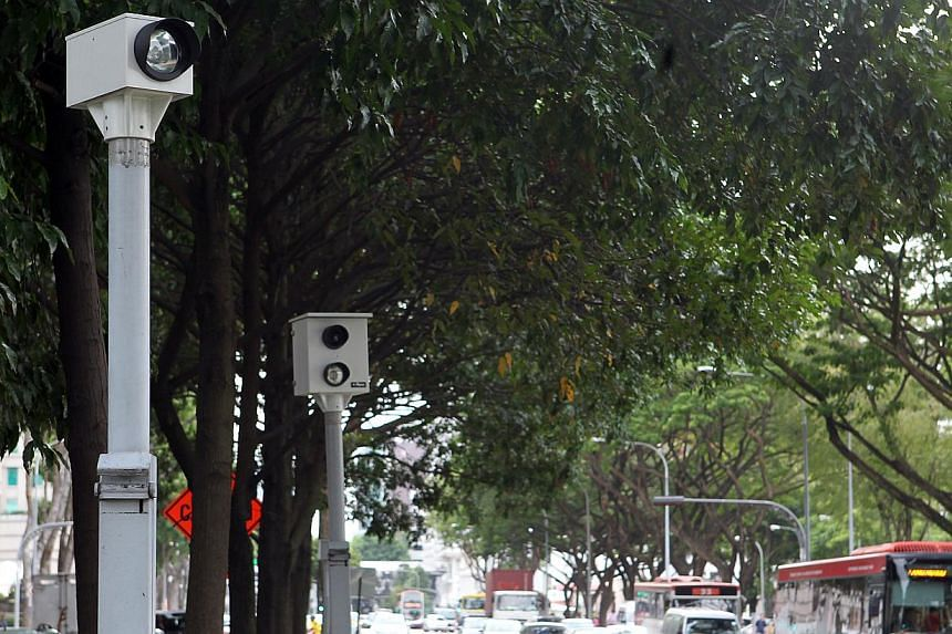 Drivers hoping to beat the red light at five busy intersections should be put off by new digital red light cameras beginning operations onMarch 1, 2014. -- ST FILEPHOTO: LAU FOOK KONG