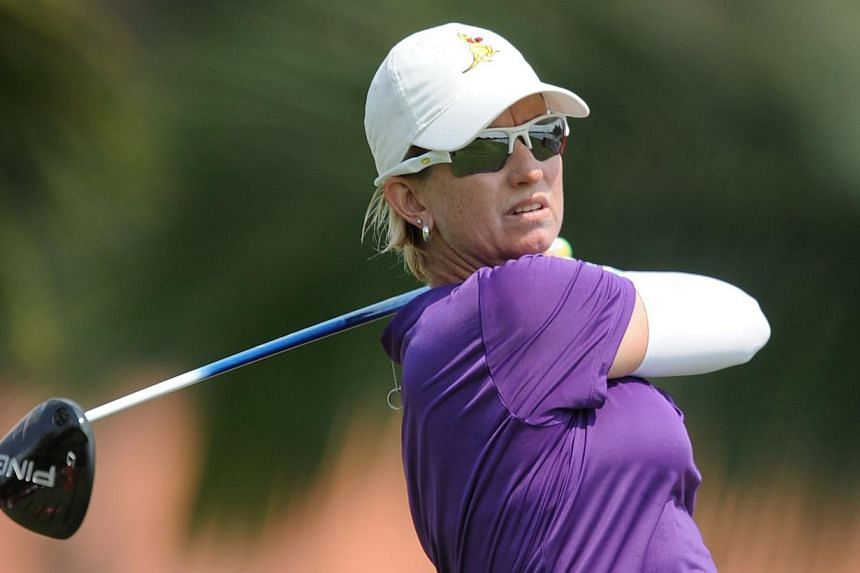 Karrie Webb of Australian takes a shot during round one of the 2014 HSBC Women's Champions golf tournament in Singapore on Feb 27, 2014. Webb has set the pace after the opening round of the HSBC Women's Champions tournament at the Sentosa Golf Club o