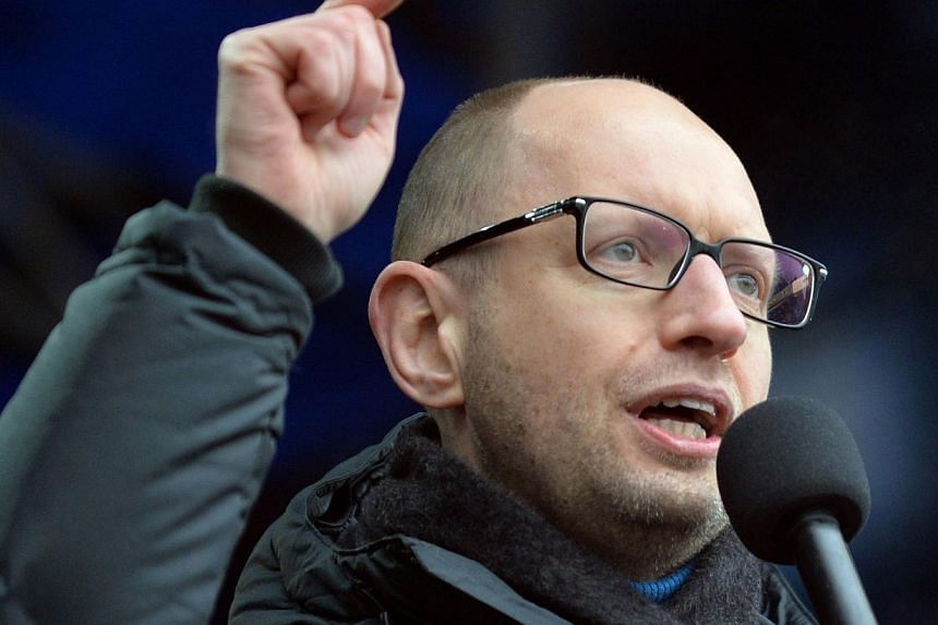 Arseniy Yatsenyuk, one of the leaders of the opposition Batkivshchyna party, gestures as he speaks during a Ukrainian opposition rally on Independence Square in Kiev on Feb 9, 2014. Ukraine's parliament on Thursday approved the nomination of pro-EU Y