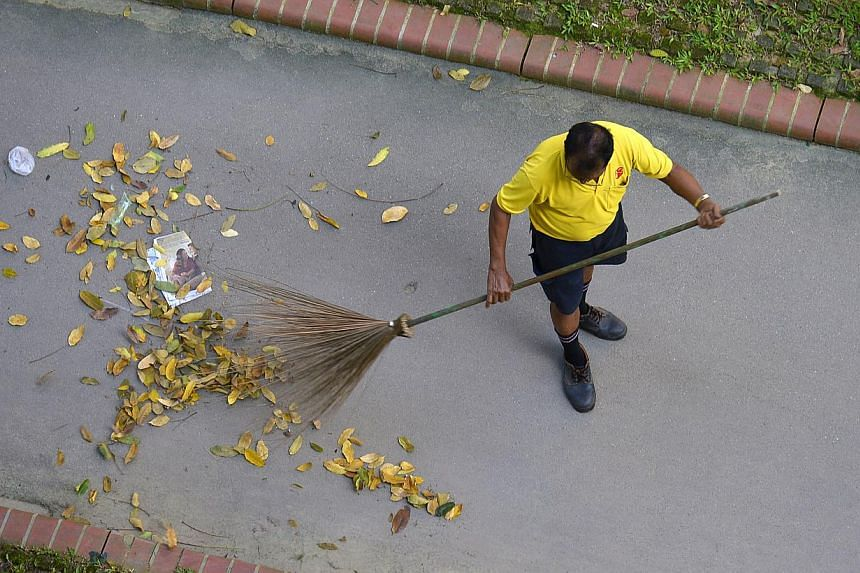 Half a million residents in estates managed by eight town councils will have to pay higher service and conservancy charges (S&CC) from April 1, 2014. -- ST FILE PHOTO: ASHLEIGH SIM