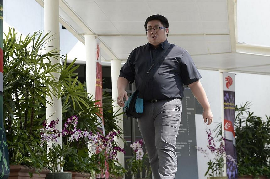 Lau Teck Guan, 34,was fined $5,000 on Thursday, Feb 27, 2014, for punching and slamming a teenager's head against the steering wheel of a racing game machine. -- ST FILE PHOTO: DESMOND LIM