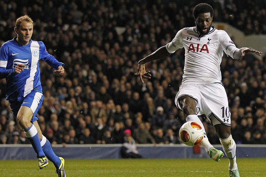 Tottenham Hotspur's Togolese striker Emmanuel Adebayor (right) scores their third goal during the Uefa Europa League round of 32, 2nd leg, football match between Tottenham Hotspur and FC Dnipro Dnipropetrovsk at White Hart Lane in north London on Feb