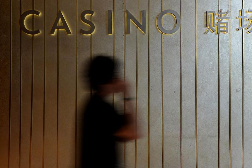 Thirteen people - nine men and four women - have been arrested for their suspected involvement in issuing illegal loans to players in the Marina Bay Sands casino. -- ST FILE PHOTO:MUGILAN RAJASEGERAN