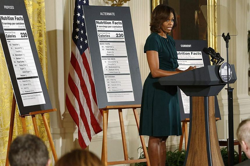 US first lady Obama unveils proposed updates to nutrition facts labels during remarks in the East Room of the White House in Washington. -- PHOTO: REUTERS