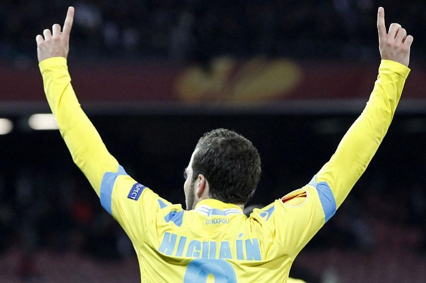 Napoli's French and Argentinian forward Gonzalo Higuain celebrates after scoring during the Uefa Europa League round of 32 second leg football match between SSC Napoli and Swansea City AFC in San Paolo Stadium on Feb 27, 2014. -- PHOTO: AFP