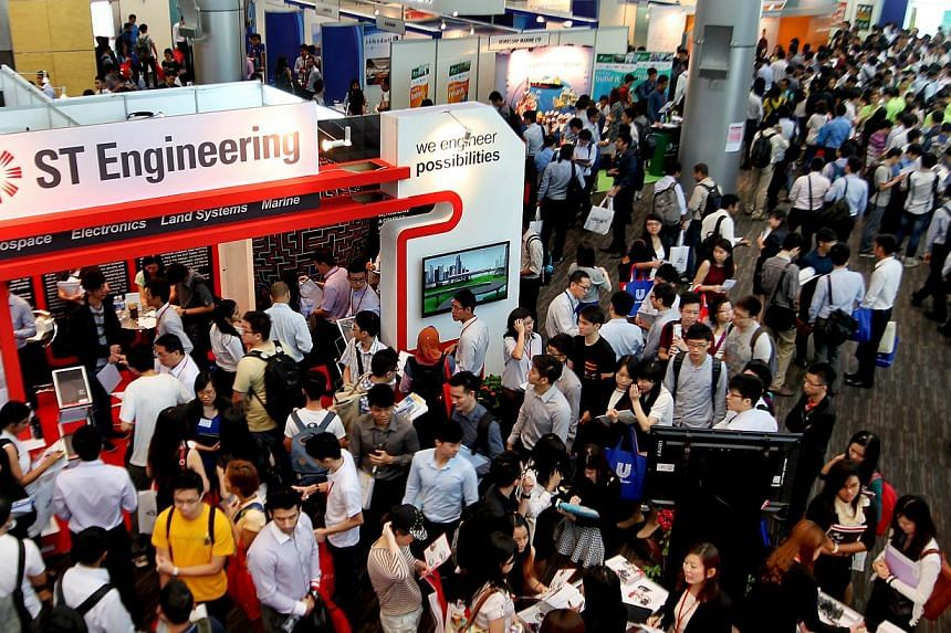 Crowd at the Nanyang Technological University (NTU) Career Fair held on Feb 18, 2014. About nine in 10 graduates from the National University of Singapore, NTU and Singapore Management University were able to find employment within six months of fini