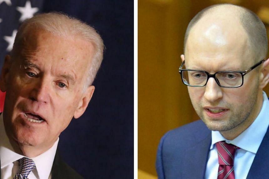 "United States Vice-President Joe Biden (left) promised Ukraine's interim Prime Minister Arseniy Yatsenyuk ""full"" support as they seek to head off Russian influence. -- FILE PHOTOS: AFP"