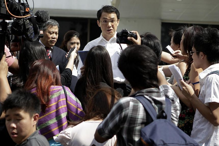 National University of Singapore law professor and former district judge Tey Tsun Hang addresses the crowd of reporters outside the courtroom on July 27, 2012. -- ST FILE PHOTO: WONG KWAI CHOW