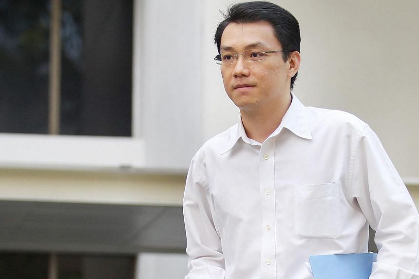 Tey Tsun Hang, a lecturer in the law faculty at the National University of Singapore, was charged in court on July 27, 2012. -- TNP FILE PHOTO: GARY GOH