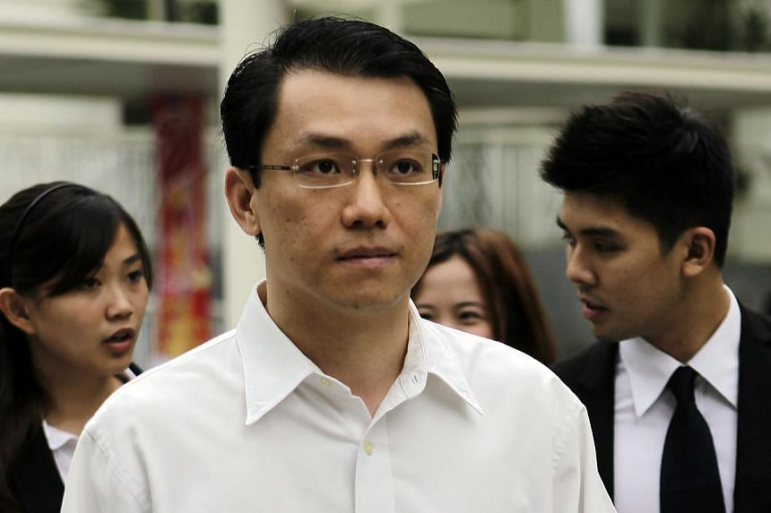 National University of Singapore law professor and former district judge Tey Tsun Hang (front) arriving at the Subordinate Court with his lawyers on Aug 3, 2012. -- ST FILE PHOTO: WONG KWAI CHOW