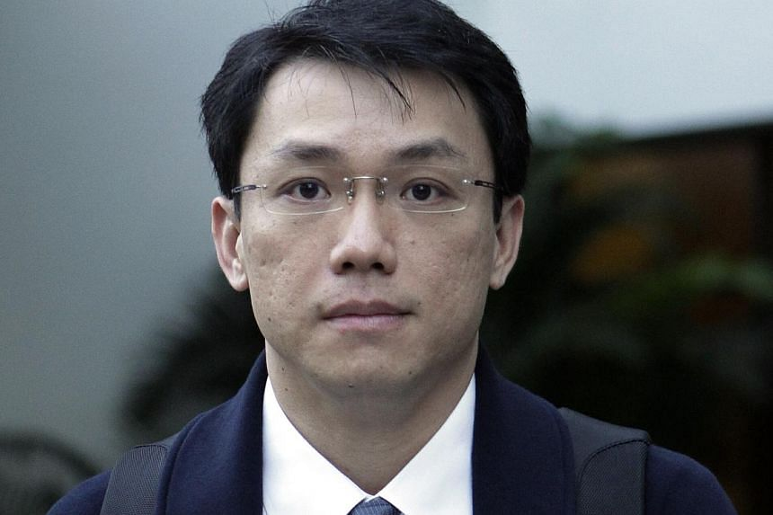 Law professor Tey Tsun Hang leaving the Subordinate Courts on April 1, 2013. -- ST FILE PHOTO: WONG KWAI CHOW