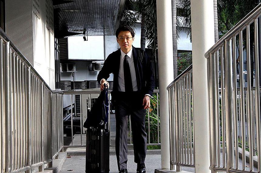 Tey Tsun Hang outside the court on April 15, 2013. -- ST FILE PHOTO: CHEW SENG KIM