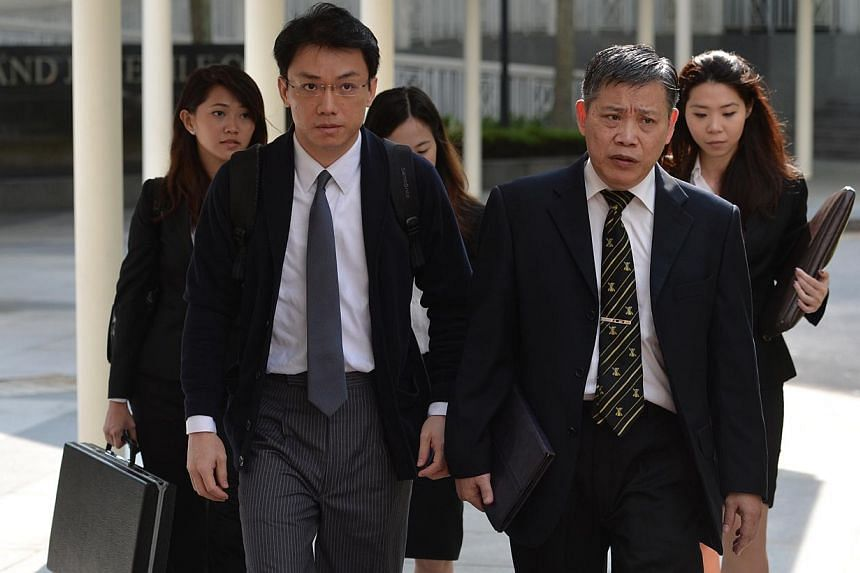 Law professor Tey Tsun Hang (left) arriving at the Subordinate Court on May 14, 2013. -- ST FILE PHOTO: CAROLINE CHIA