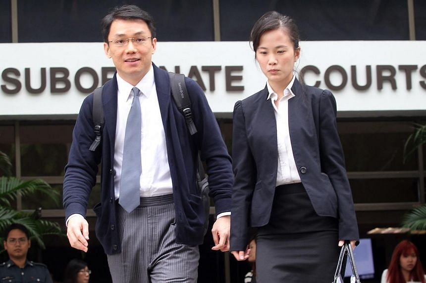 Law professor Tey Tsun Hang, seen here leaving the Subordinate Court with lawyer Yang Sara, was convicted on May 28, 2013, of all six counts of corruptly accepting sex and gifts from his student at the National University of Singapore in return for g