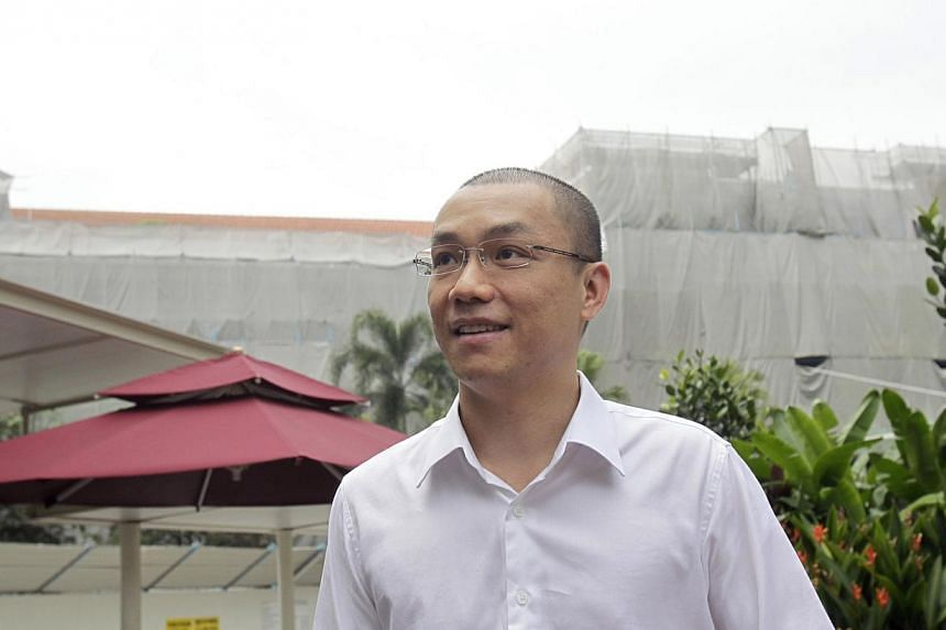 Former law professor Tey Tsun Hang arriving at the Subordinate Courts on June 26, 2013, to begin his five-month jail term for corruption. -- ST FILE PHOTO: KEVIN LIM CP