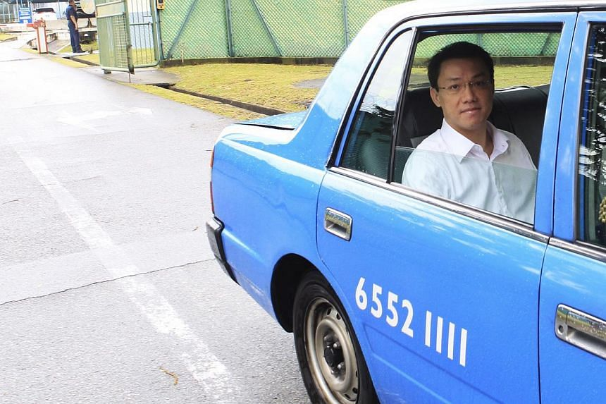 Former law professor Tey Tsun Hang leaving Selarang Park Community Supervision Centre on Oct 5, 2013, after the electronic tag, which he was required to wear as part of the home detention order, was removed. -- ST FILE PHOTO: KEVIN LIM