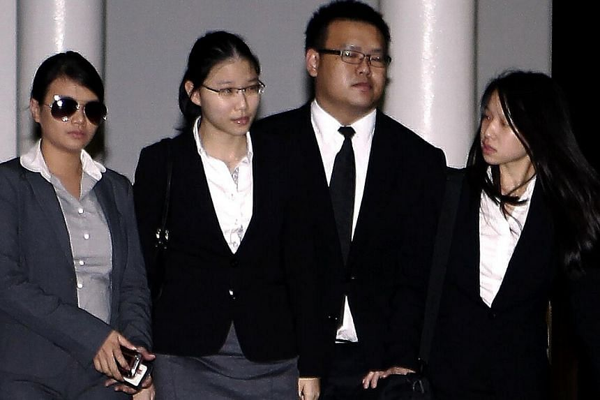 Ms Darinne Ko Wen Hui (second from left) leaving court with CPIB officers after testifying as a prosecution witness in the sex-for-grades trial. -- ST FILE PHOTO: WONG KWAI CHOW
