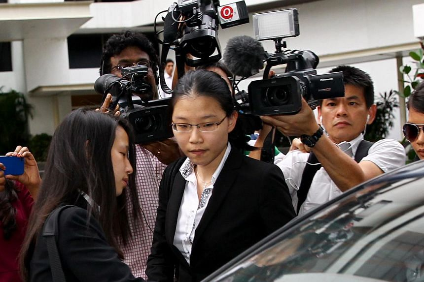Ms Darinne Ko Wen Hui leaving the court after testifying as a prosecution witness on Day 1 of the sex-for-grades trial on Jan 10, 2013. -- TNP FILE PHOTO: BENJAMIN SEETOR