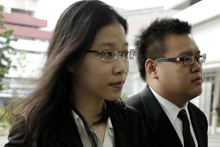 Ms Darinne Ko Wen Hui arrives at the Subordinate Courts with her lawyer on Jan 11, 2013. -- ST FILE PHOTO: WONG KWAI CHOW