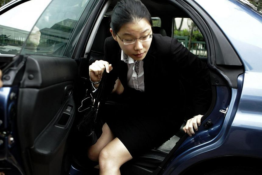 Ms Darinne Ko Wen Hui arriving at the Subordinate Courts on Jan 14, 2013, the third day of the sex-for-grades corruption trial involving law professor Tey Tsun Hang. -- ST FILE PHOTO: WONG KWAI CHOW